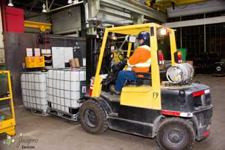 Jaspro Services forklift operator moving pallets of goods.